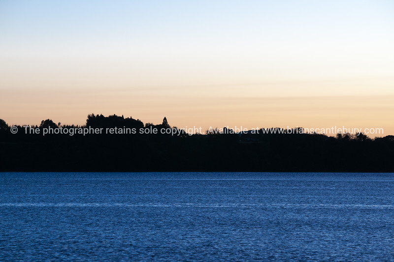 """Sunrise sky, and silhouette skyline of Maungatapu from the other side of Tauranga Harbour. See;  <a href=""""http://www.blurb.com/b/3811392-tauranga"""">http://www.blurb.com/b/3811392-tauranga</a> mount maunganui landscape photography, Tauranga Photos; Tauranga photos, Photos of Tauranga Also see; <a href=""""http://www.brianscantlebury.com/Events"""">http://www.brianscantlebury.com/Events</a>"""