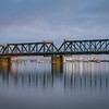 Tauranga's historic steel truss railway bridge in morning light
