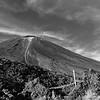 Mount Ngauruhoe rising from surrounding mountainous volcanic countryside