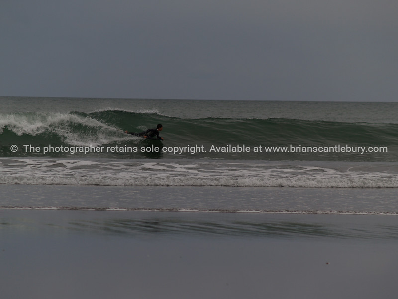 Surfing on grey day.