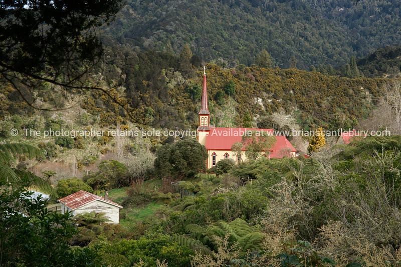 Jerusalem, New Zealand, St Joseph's historic Catholic Church set amongst the rugged bush clad hills above the Whanganui River. New Zealand photographic stock images.