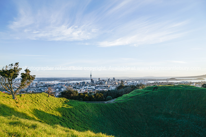 Shadow in crater Mount Eden with Auckland Harbour and skyline with Sky Tower landmark