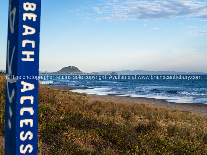 Mount Maunganui in distance, Beach Access sign.
