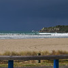 """Sun hits the beach under dark storm clouds creating a striking image over the oceanbeach, Mount Maunganui, New Zealand. Tauranga is New Zealands 5th largest city and offers a wonderfull variety of scenic and cultural experiences. Tauranga stock images Tauranga scenics. See;  <a href=""""http://www.blurb.com/b/3811392-tauranga"""">http://www.blurb.com/b/3811392-tauranga</a> mount maunganui landscape photography, Tauranga Photos; Tauranga photos, Photos of Tauranga Also see; <a href=""""http://www.brianscantlebury.com/Events"""">http://www.brianscantlebury.com/Events</a>"""