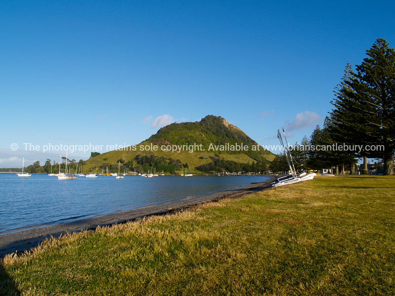 """Mount maunganui, Pilot Bay scene. Tauranga is New Zealands 5th largest city and offers a wonderfull variety of scenic and cultural experiences. Tauranga stock images Tauranga scenics. See;  <a href=""""http://www.blurb.com/b/3811392-tauranga"""">http://www.blurb.com/b/3811392-tauranga</a> mount maunganui landscape photography, Tauranga Photos; Tauranga photos, Photos of Tauranga Also see; <a href=""""http://www.brianscantlebury.com/Events"""">http://www.brianscantlebury.com/Events</a>"""