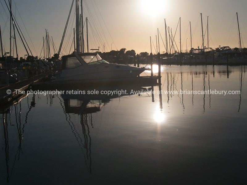 """Tauranga scenics.<br /> <br /> Marina boats backlit by morning sun. Tauranga is New Zealands 5th largest city and offers a wonderfull variety of scenic and cultural experiences. Tauranga stock images Tauranga scenics. See;  <a href=""""http://www.blurb.com/b/3811392-tauranga"""">http://www.blurb.com/b/3811392-tauranga</a> mount maunganui landscape photography, Tauranga Photos; Tauranga photos, Photos of Tauranga Also see; <a href=""""http://www.brianscantlebury.com/Events"""">http://www.brianscantlebury.com/Events</a>"""