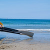 Surf boat on beach with oars