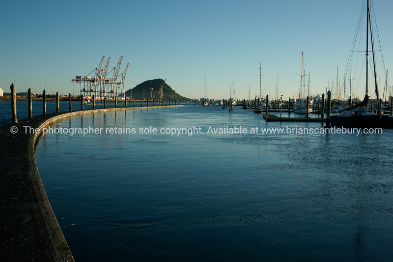 "Port of tauranga and Mount maunganui on horizon. Tauranga is New Zealands 5th largest city and offers a wonderfull variety of scenic and cultural experiences. Tauranga stock images Tauranga scenics. See;  <a href=""http://www.blurb.com/b/3811392-tauranga"">http://www.blurb.com/b/3811392-tauranga</a> mount maunganui landscape photography, Tauranga Photos; Tauranga photos, Photos of Tauranga Also see; <a href=""http://www.brianscantlebury.com/Events"">http://www.brianscantlebury.com/Events</a>"