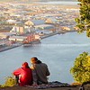 "Young couple share early morning light from top of Mount maunganui with the port and industrial area in background. Tauranga is New Zealands 5th largest city and offers a wonderfull variety of scenic and cultural experiences. Tauranga stock images Tauranga scenics.<br /> Model Release; no. See;  <a href=""http://www.blurb.com/b/3811392-tauranga"">http://www.blurb.com/b/3811392-tauranga</a> mount maunganui landscape photography, Tauranga Photos; Tauranga photos, Photos of Tauranga Also see; <a href=""http://www.brianscantlebury.com/Events"">http://www.brianscantlebury.com/Events</a>"