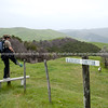 Tora Walk, crossing a fence stile at Blairlogie Junction. New Zealand Image.