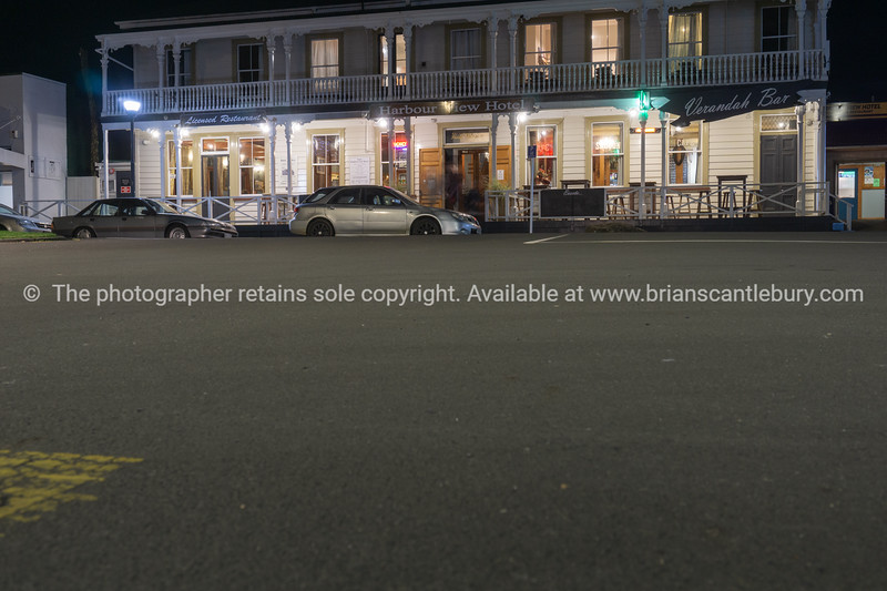 Raglan street at night with Harbour View Hotel at end.