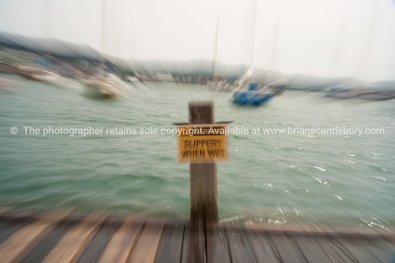 Slippery when wet sign in zoom blur effect