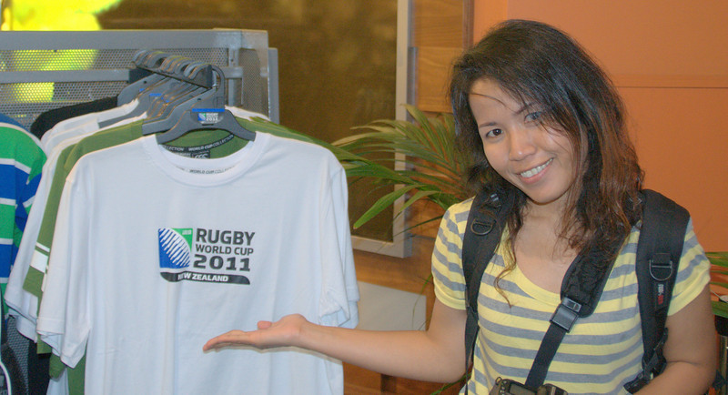 Fon at Auckland airport in front of rugby world cup 2011 t-shirts in November 2010