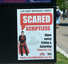 A poster for a comedy show outside the Court Theatre in Christchurch, New Zealand in November 2010... Scared scriptless, clever