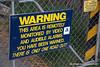 Warning that monitoring and surveillance takes place at Lake Alexandrina in New Zealand in November 2010