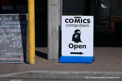 Comics compulsion sign in Christchurch, New Zealand in November 2010.