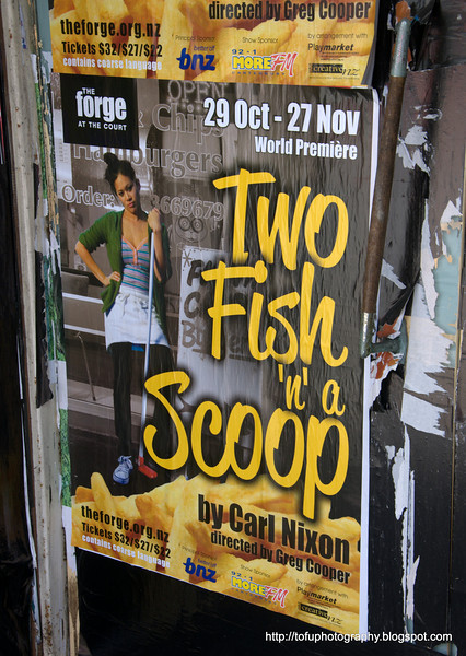 Two fish 'n a scoop theatre poster in Christchurch, New Zealand in November 2010. Scoop refers to a serving of chips!