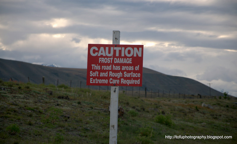 Frost damage sign on a road at Lake Tekapo in New Zealand in November 2010