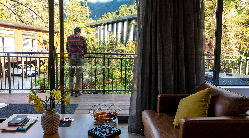 Rainforest Retreat in Franz Josef New Zealand: Balcony from the inside of the Deluxe Tree Lodge