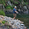 Russell trying to catch a trout in the Ohinemuri River.