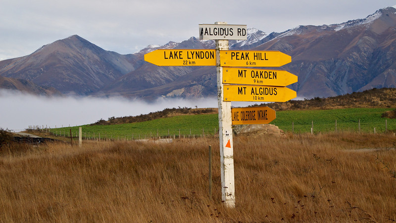 "Road sign on a foggy morning. Peak Hill, Mt. Oakden and Mt. Algidus are all high country stations as well as hills and mountains. Mt. Algidus is the most well known as the home of Mona Anderson and the setting for a string of books including ""A River Rules My Life""."