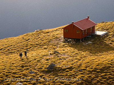 Trampers approaching Brewster Hut.