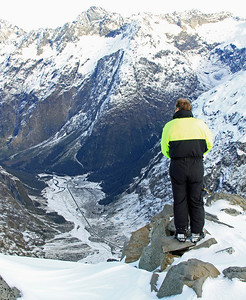 Alistair Pearce (Avalanche Technician) looks over the Milford Road and upper Hollyford Valley from near Crosscut Hut.