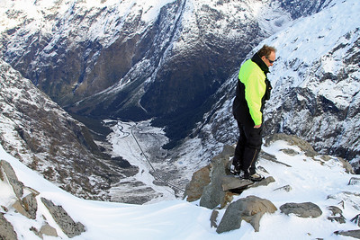 Alistair Pearce (Avalanche Technician) looks over the Milford Road and upper Hollyford Valley from near Crosscut Hut