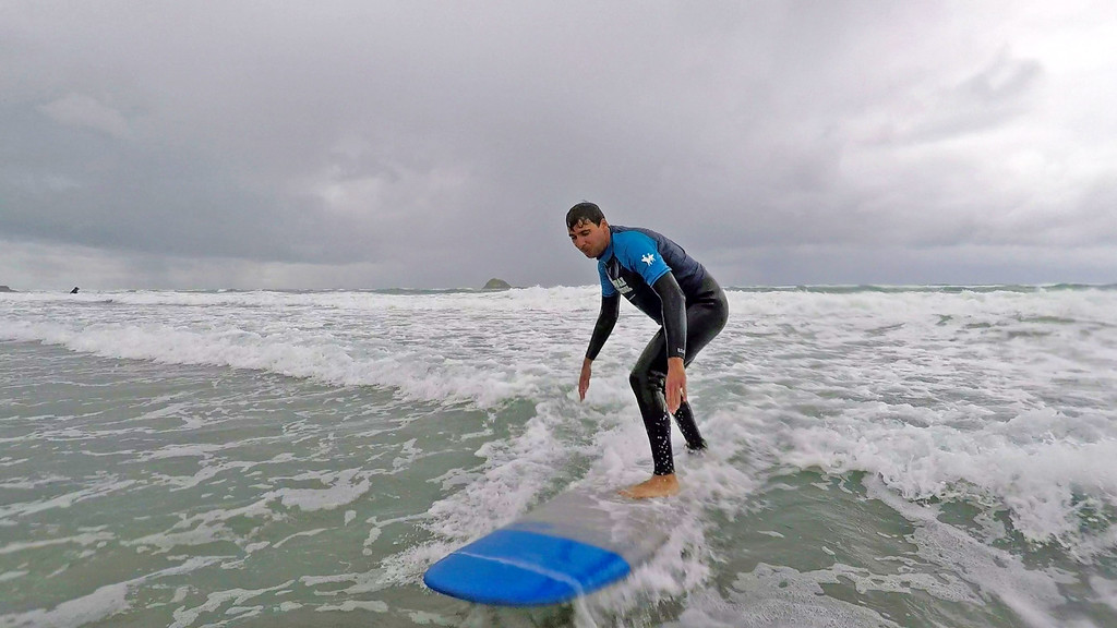 Surfing in Auckland at Muriwai Beach with Muriwai Surf School