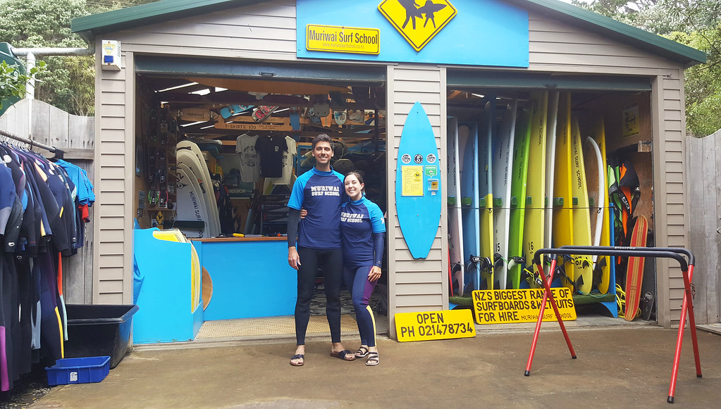 Learning how to surf at Muriwai Surf School near Auckland, New Zealand