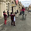 2018-02-18 - 05 Famiy members take photo of woman riding a bike in Oamaru, NZ