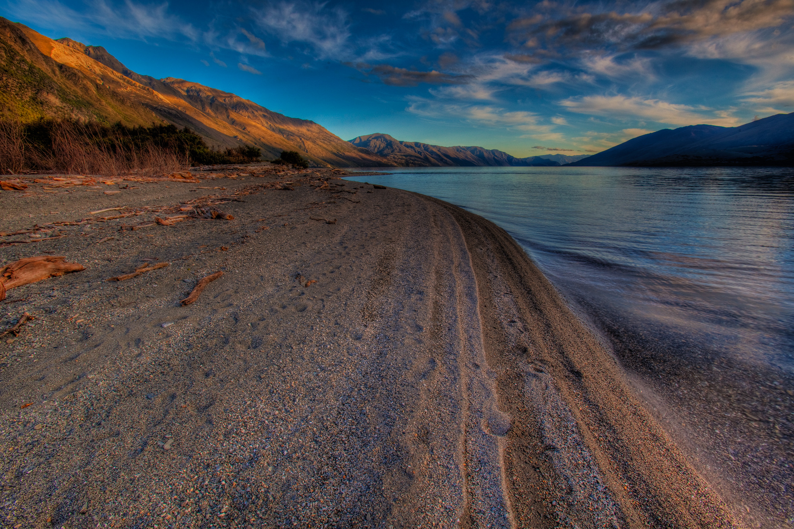 Sunset on the shores of an unnamed lake outside of Queenstown, New Zealand