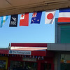 Flags of all the competing nations are on all the shops in Milford.