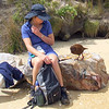 Robyn trying to eat her lunch with out mother Weka getting any. West End beach on Ulva Island.