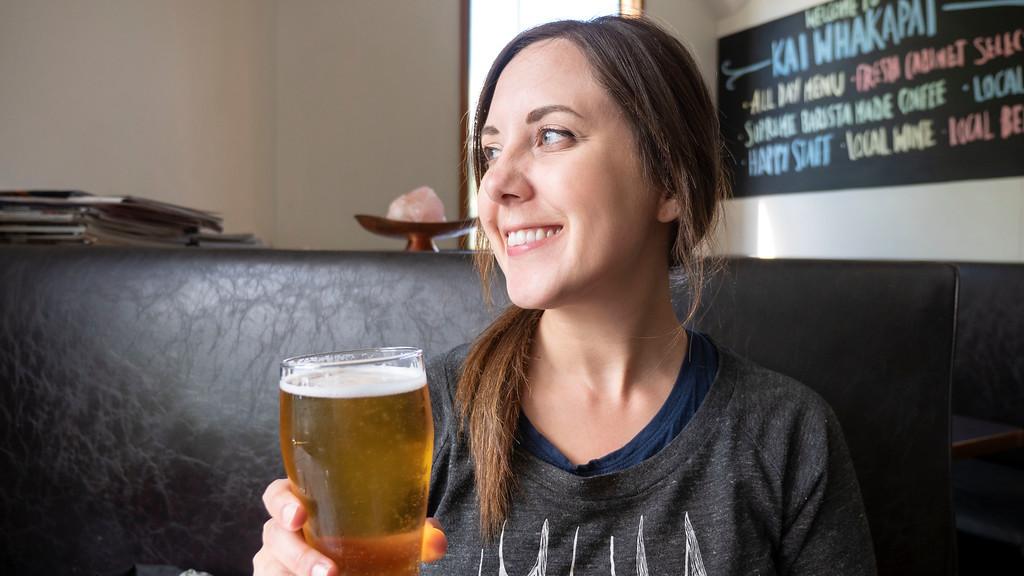 Lauren enjoying a beer in Wanaka New Zealand at Kai Whakapai