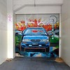 Painting of a car in front of a garage in Wellington, New Zealand in January 2017