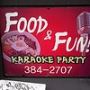 Food and fun karaoke party sign seen in Wellington, New Zealand in January 2017