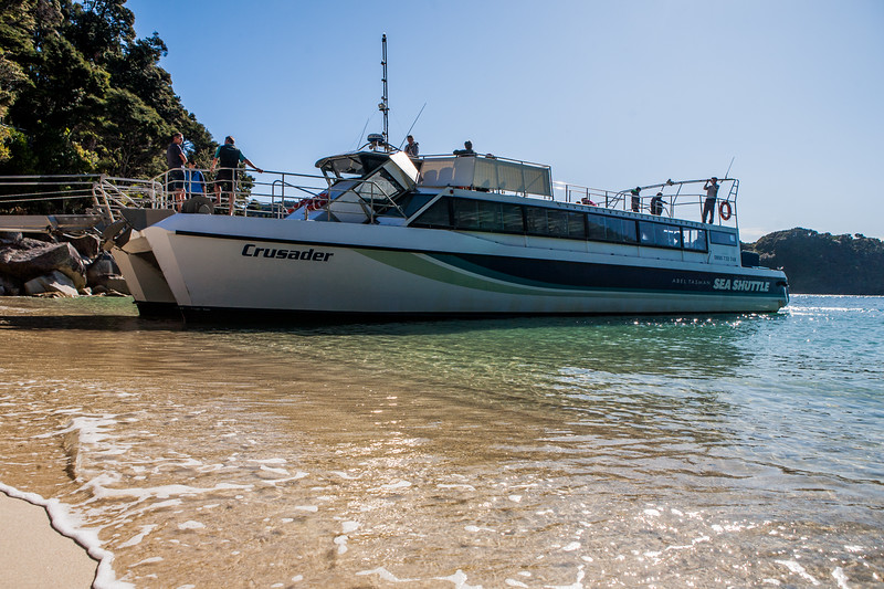 Sea shuttle waiting at Medlands Beach in Abel Tasman National Park, New Zealand