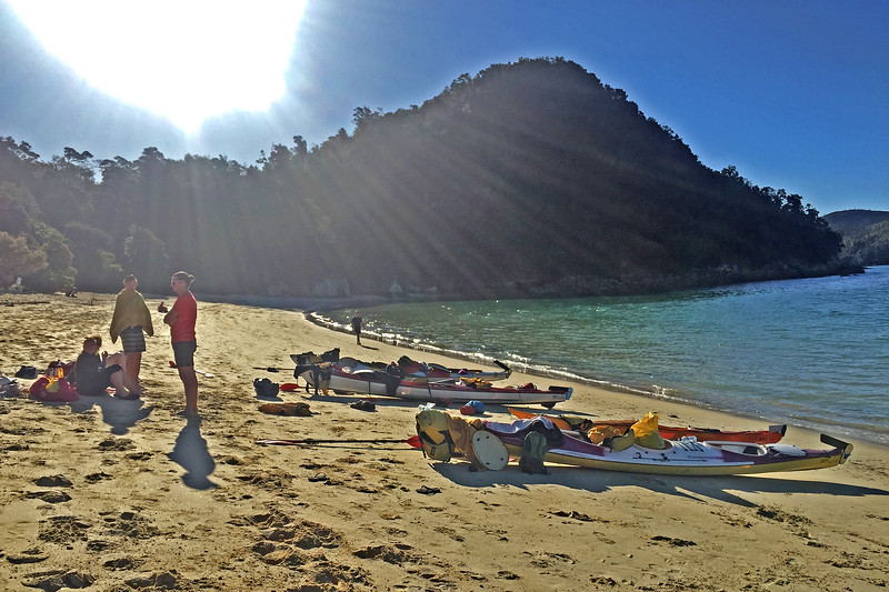 Kayaks on the beach at Anchorage in Abel Tasman National Park, New Zealand