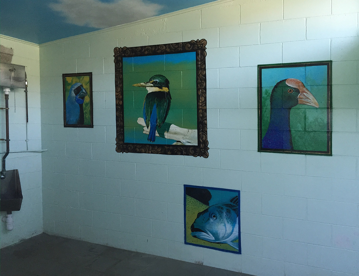 Wall paintings inside public toilet at Tata Beach - Tarakohe, New Zealand