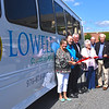 Lowell City officals and members of the Friends of Lowell Senior Center cut the ribbon for the new bus for the center, L-R, Riter Mercier City Councilor, Dr. Joe Downes President of the Friends of Lowell Seniors, Dave Conway City Councilor, Claire Brodeur Sec. of Friends of Lowell Seniors, Lenny Gendreon, Mayor William Samaras, Vice Mayor Vesna Nuon, City Manager Eilleen Donoghue, and Beverly Gonsalves. SUN/David H.Brow