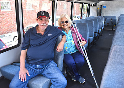 Trying out the inside of the new Lowell Senior Center bus is L-R, Michael Laurent of Lowell and Sissy Paradis of Dracut. SUN/David H.Brow