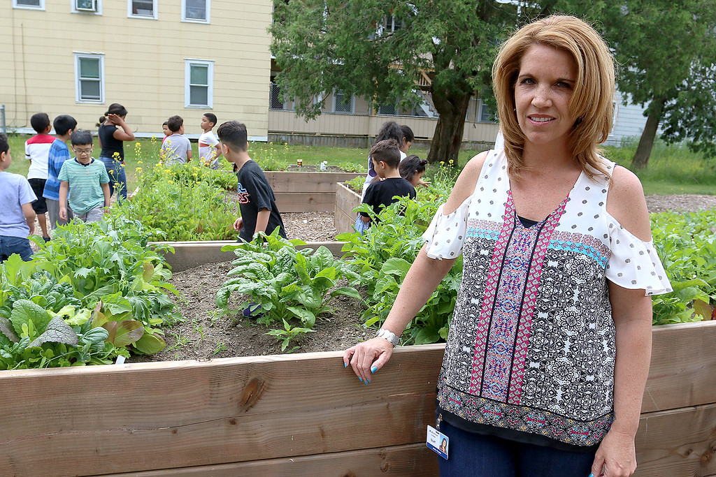 """. A new community garden, they are calling \""""Shelbie\'s Seed of Promise,\"""" was recently planted at Father Maguires Park in memory of Shelbie Murphy. Second grade students from McAvinnue Elementary School check out the garden behind Shelbie\'s mom Jackie Murphy on Friday at the garden. SUN/JOHN LOVE"""