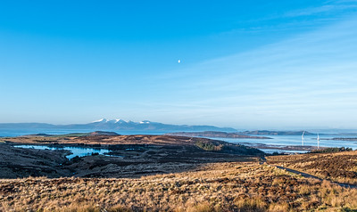 Winter Sun Reflecting on a Cold Arran and Two Wind Turbines