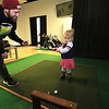 A new indoor golf facility has opened in Fitchburg on Airport Road called Birdies. Owner Patrick Murphy helps his daughter teagan, 2, as she tries it out. SENTINEL & ENTERPRISE/JOHN LOVE