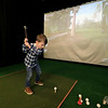 A new indoor golf facility has opened in Fitchburg on Airport Road called Birdies. Owner's son Kevin Murphy, 4, tries out his swing at the facility on Thursday afternoon. SENTINEL & ENTERPRISE/JOHN LOVE
