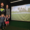 A new indoor golf facility has opened in Fitchburg on Airport Road called Birdies. Owner Patrick Murphy with wife Katy, son Kevin, 4, and daughter Teagan, 2. The view on the screen is the 17 hole at TPC Sawgrass in Ponte Vedra Beach, FLorida. SENTINEL & ENTERPRISE/JOHN LOVE