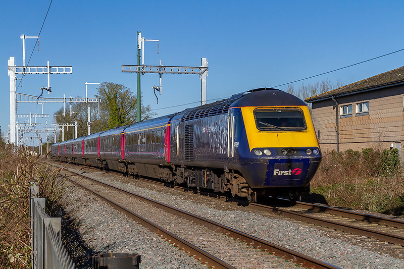 5th Apr 2018:  at 11 minutes passed 9 1L32 thee 06.49 from Swansea to Paddington rushes through the site of Steventon Station. 43189 is leading but it's days are numbered as by this time next year all the 8 car HSTs should have been replaced by IETs.  Is there any where else in the world that the catenery is as over engineers as this?