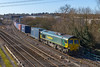 12th Feb 2018:  Today routed via the station at Didcot is 66550 working 4M55 from Southampton to Lawley Street.  The cables in the picture taken from the footbridge at the North Junction are unavoidable unless a long tele is used.  Can  be cloned out though.
