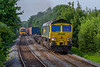 12th Jun 2018:  66552 is on the climb through Dilton Marsh with the Tuesday & Thursday only 4O71 from Wentloog to Southampton Maritime.  166216 forming 2E28 from Warminster to Cheltenham Spa is drifting down the hill.